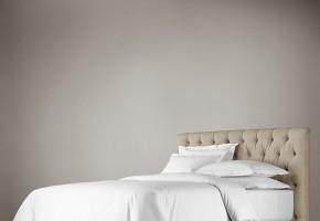 מיטה מרופדת ב גב מיטה קפיטונז'  עם קפתורים ו רגל חריטה מוצב